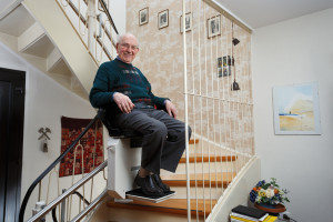 grandfather using the stairlift